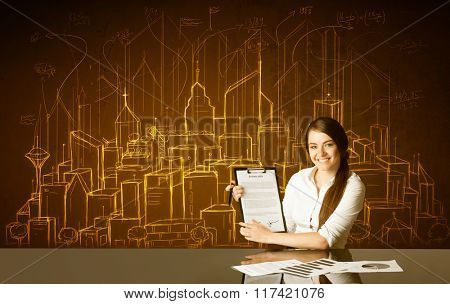 Businesswoman sitting at the black table with hand drawn buildings and numbers on the background