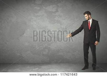 Business person throwing with empty copyspace in a room