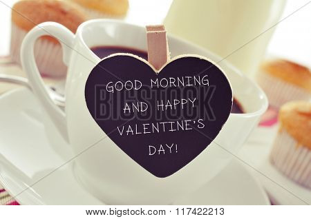 closeup of a porcelain cup of coffee with a heart-shaped signboard with the text good morning and happy valentines day, on a table set for breakfast