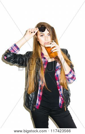 Modern cool blonde teenage girl drinking beer