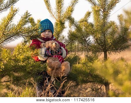 Young Happy Boy Playing Outdoor With Teddy Bear Toy