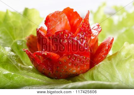 Rose From Strawberry On A Green Lettuce Leaf