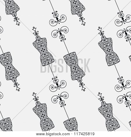 Black and white seamless pattern with vintage tailor's dummy for female body