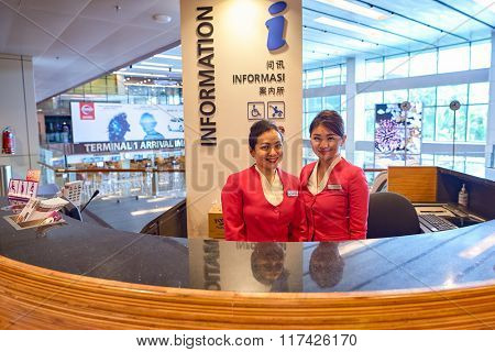 SINGAPORE - NOVEMBER 03, 2015: staff at Changi airport information desk. Singapore Changi Airport, is the primary civilian airport for Singapore, and one of the largest transportation hubs in Asia