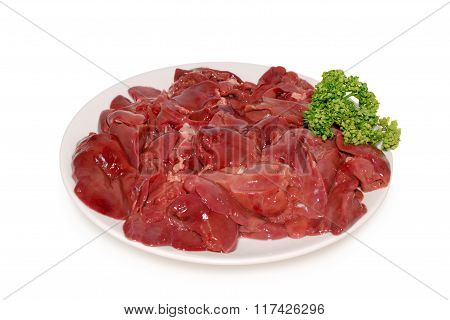 Fresh raw chicken livers on the plate against a white background
