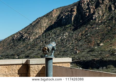Viewing Scope Facing Mountain Range