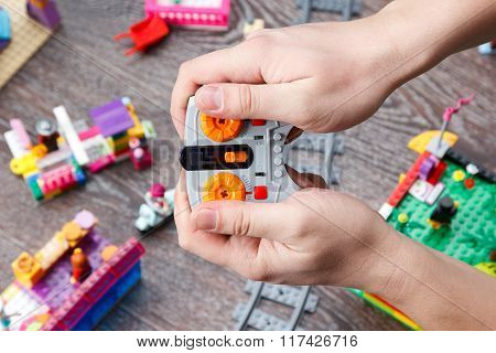 Male Hands Holding Toy Remote Control