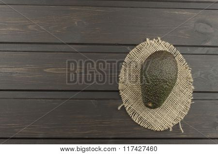 Fresh ripe avocado on a wooden table