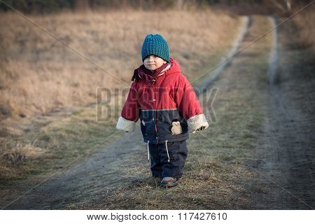 Young Happy Boy Playing Outdoor On Country Road