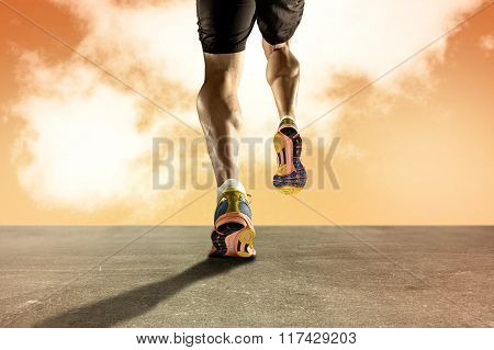 Strong Athletic Legs With Ripped Calf Muscle Of Young Sport Man Running On Grunge Asphalt Road At Or
