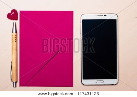 Pink Envelope Heart And Phone On Table