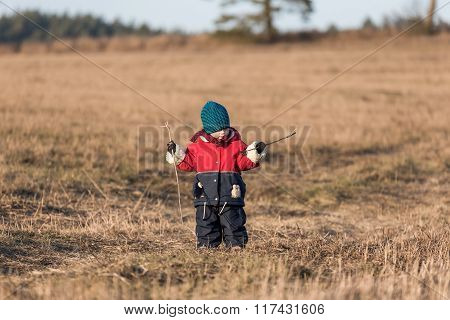 Young Happy Boy Playing Outdoor At Spring