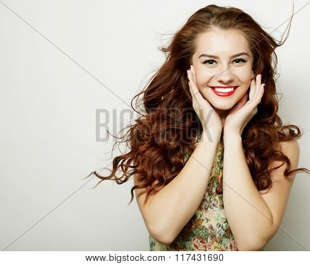 Beautiful young surprised woman.