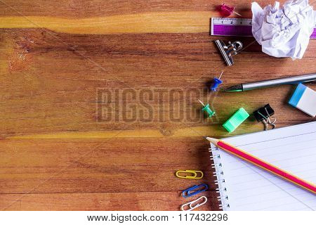 School or Office Supplies on Top of Wooden Table. Captured at Right Border Frame