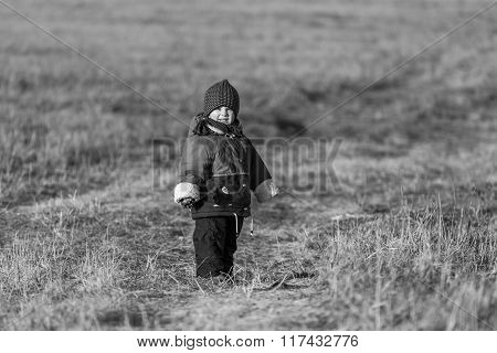 Young Happy Boy Playing Outdoor At Spring. Black And White