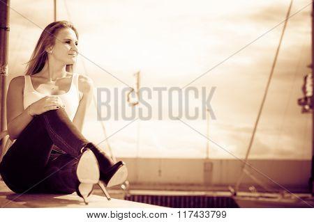 Woman Sitting On Marina