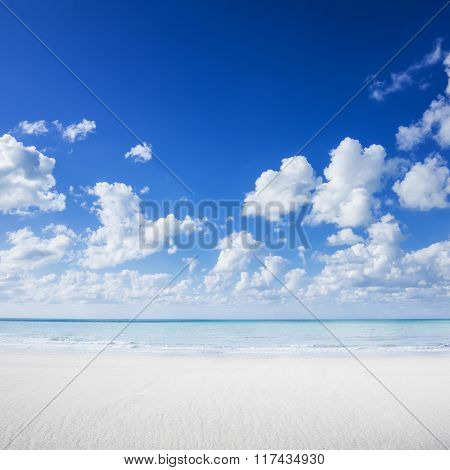 White Sand Beach, Tropical Ocean And Blue Sky