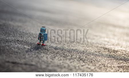 Little Retro Tin Robot Walking Down Road