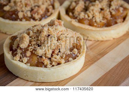 Small Apple Tart Desserts On Wood Cutting Board