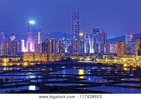 Shenzhen citscape at night , view from hiong kong countryside