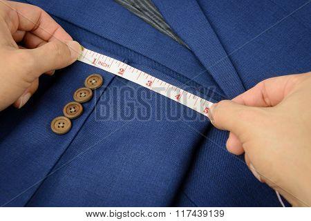 Measurement Tape On Blue Suit