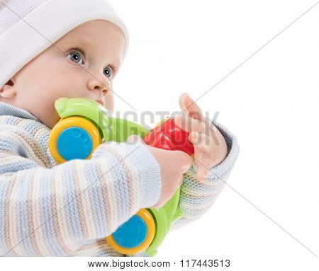 caucasian baby child kid boy playing with car toy isolated on white studio shot