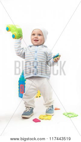 little child baby smiling playing with car isolated on white studio shot warm cloth