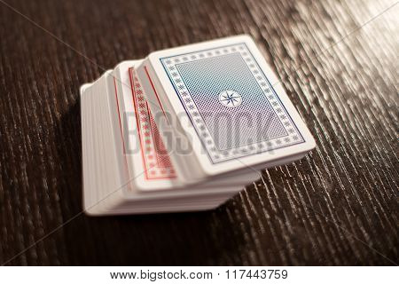 Deck Of Stacked Playing Cards On A Table