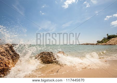 Splashes Of Sea Wave On The Beach, Blue Sky