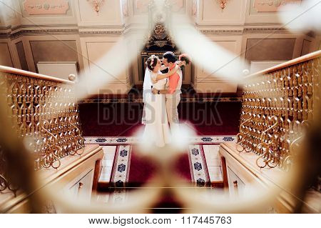 Happy Stylish Couple Lovely Hugging On Background Luxurious Interior Of The Amazing Castle. Heart Si