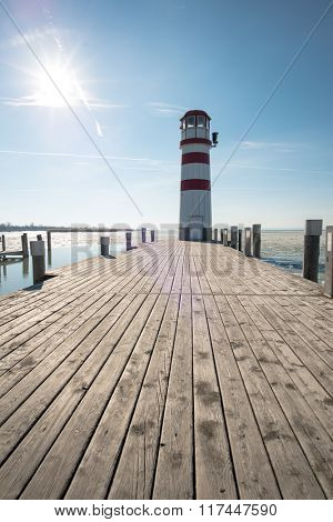 Lighthouse at the end of the wooden pier. Podersdorf am see, Austria