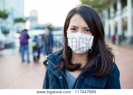 Woman wear face mask in pollution city