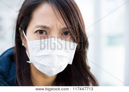 Woman wearing face mask for protection