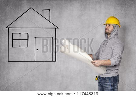 Designers Looking At House Plans