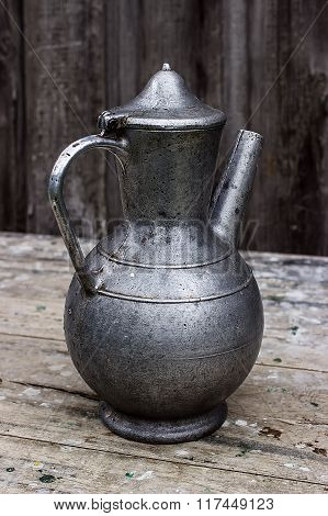 Old Metal Pitcher On A Table
