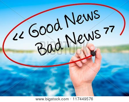 Man Hand Writing Good News - Bad News With Black Marker On Visual Screen.