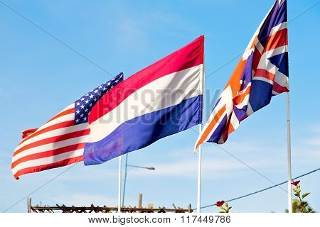 World Waving Flag In The Blue Sky  Colour And Street Lamp