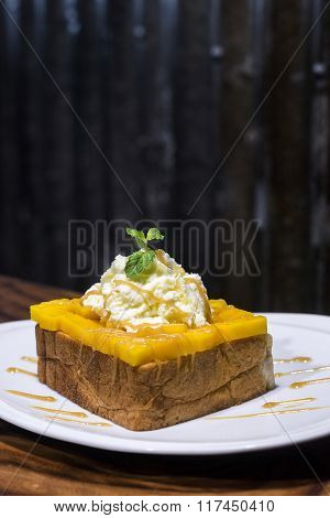 French Toast With Mango And Whipped Cream