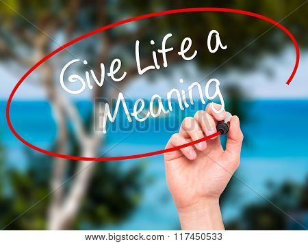 Man Hand Writing Give Life A Meaning With Black Marker On Visual Screen.