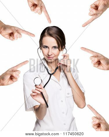 Many hands points on the medical doctor woman