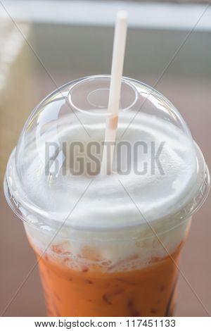Selective Focus Of Milk Tea Withmilk Foam, Macro