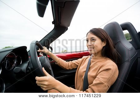 Woman in convertible car