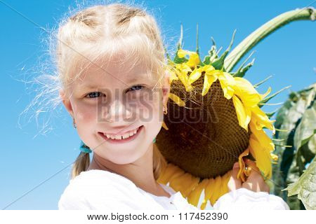 Gardening, Planting Concept - Portrait Of Lovely Girl With Sunflower