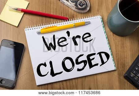 We're Closed - Note Pad With Text On Wooden Table