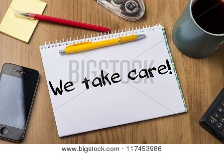 We Take Care! - Note Pad With Text On Wooden Table