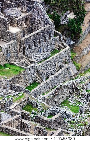 houses and ancient walls to Machu Picchu