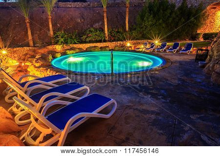 Evening view for luxury swimming pool in night illumination