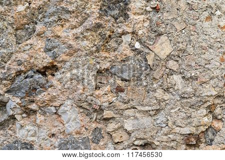 Old Bumpy Texture Of An Ancient Stone Wall