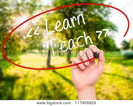 Man Hand Writing Learn - Teach With Black Marker On Visual Screen.