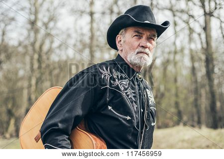 Country And Western Male Musician At The Woods